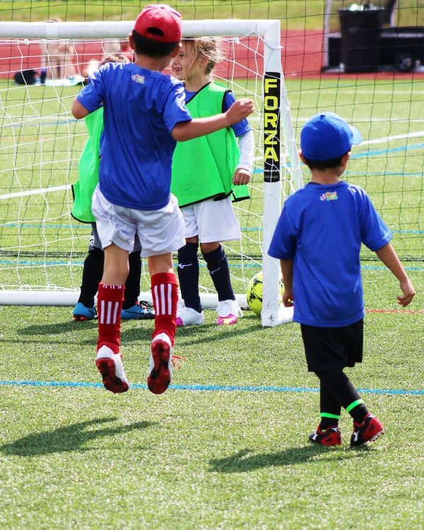 Youth Soccer League Player Scoring A Goal