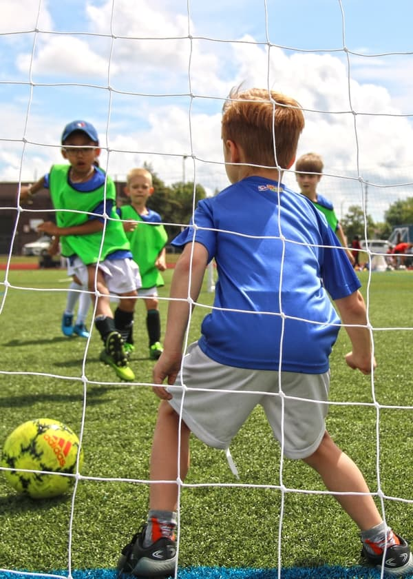 Some Kids Soccer League Players Taking A Shot On Goal